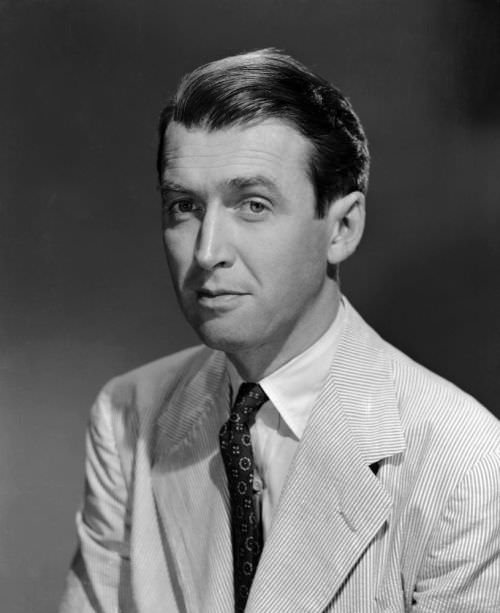 Seersucker suit and medallion print tie. Is it Jimmy Stewart or the latest Drake's Lookbook?