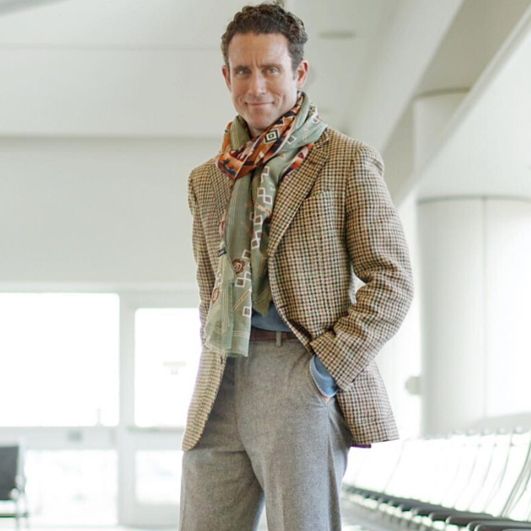 @urbancomposition s pastel green scarf matches the pattern of his sport coat.
